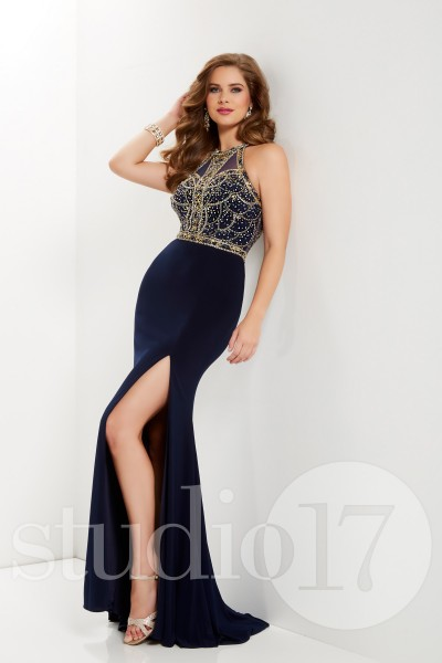 Studio 17 12689 is available in Navy Gold, Platinum Silver and in sizes 0-30.