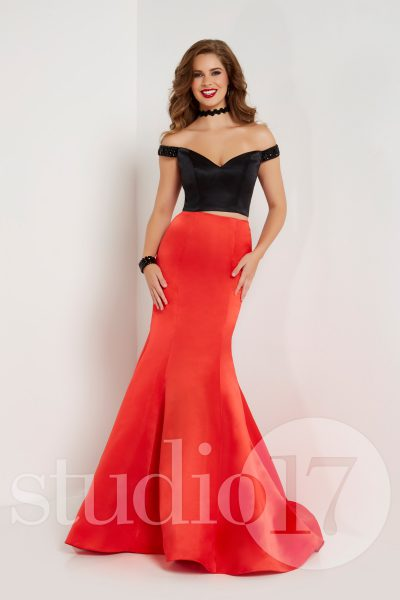 Studio 17 12678 is available in Black Emerald, Black Red and in sizes 0-30.